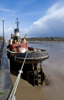 6824757 - tug boat at low tide